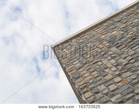 Brick stone wall corner with sky space