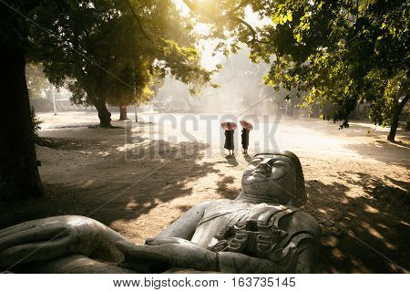 The forgotten buddha Buddha statue laying on the ground Mandalay Myanmar