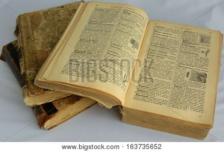 OMSK, RUSSIA - OCTOBER 10, 2016: A stack of old books on a white backgroundA stack of old books on a white background