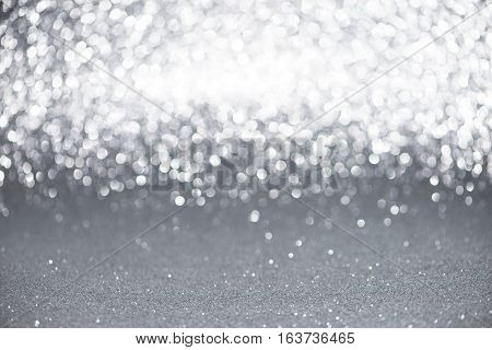 Defocused Abstract Silver Glitter With Bokeh Background