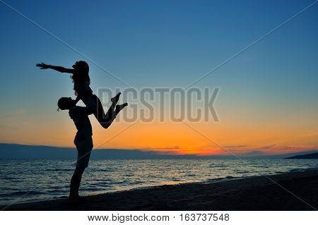 The image of two people in love at sunset.