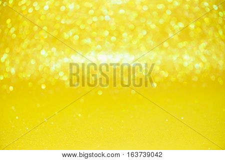 Defocused Abstract Yellow Glitter With Bokeh Background