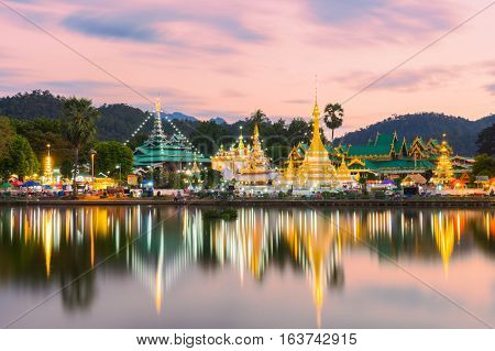 Sunset scence of Wat Jongklang - Wat Jongkham the most favourite place for tourist in Mae hong son near Chiang mai Thailand with reflect sky in water