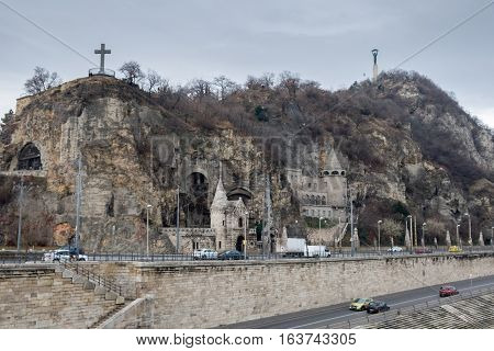 View Of Gellert Hill Cave Church From Danube River. Budapest, Hungary