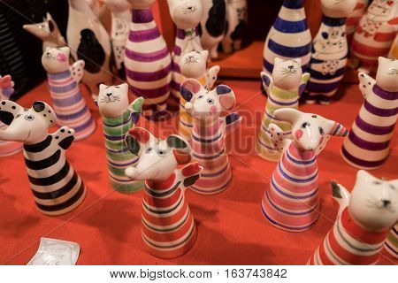 BUDAPEST HUNGARY - DECEMBER 7 2016: funny ceramic cats and mouses figurines for sale at christmas market