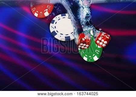 Red Dice Fall Into The Water. Casino Concept