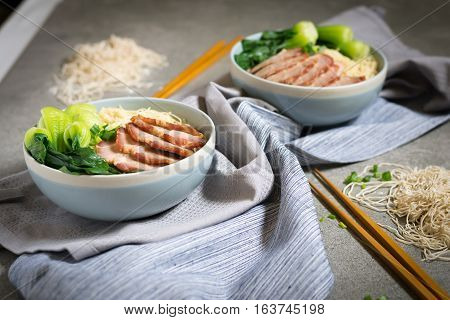Delicious Egg Noodle With Red Pork And Vegetable In Bowl Decoration