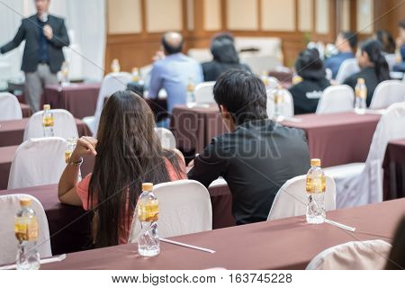 Asia People Listen In Business Seminar Presentation Hall Of Hotel Room