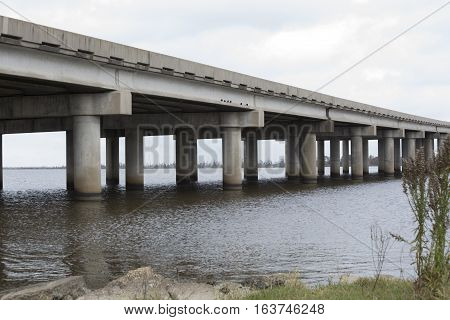 Overpass bridge over water with diminishing perspective