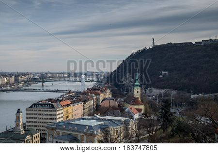 Panoramic View Of Gellert Hill At Cold Foggy Day. Budapest. Hungary
