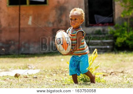 Lavena, Fiji - November 27: Unidentified Boy Plays With Rugby Ball On November 27, 2013 In Lavena Vi