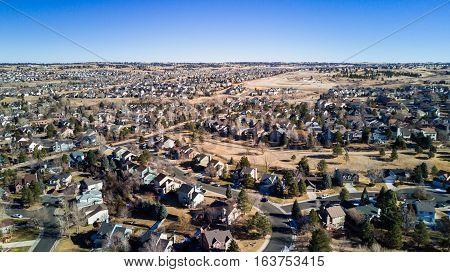 Aerial view of residential neighborhood in suburbia in snowless Winter.