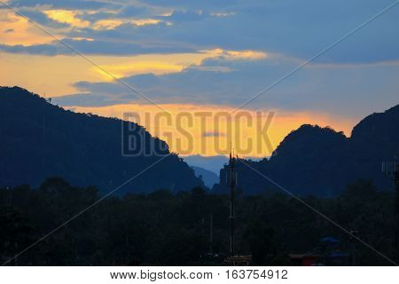 sky in sunset and raincloud colorful twilight time in city with mountain silhouette art beautiful in nature