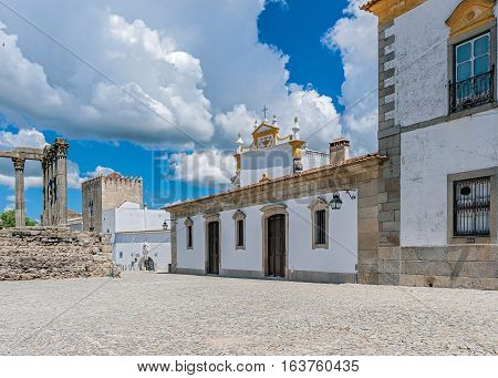 Portugal Evora . In the eastern part of the square is an ancient monastery Loyush . The monastery church is located opposite the ruins of a Roman temple of the goddess Diana .