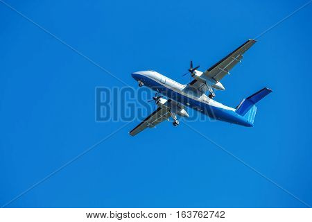 wide-body aircraft is flying blue sky turbine propeller screw take off wings