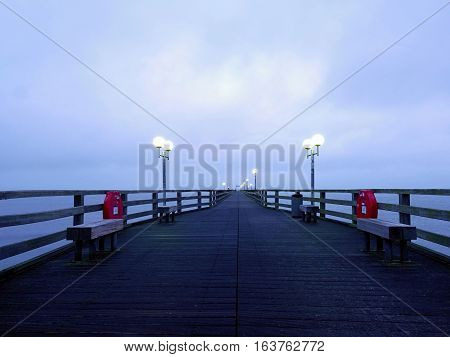 Long Touristic Mole Within Autumn Misty Morning. Wet And Slippery Wooden Floor,