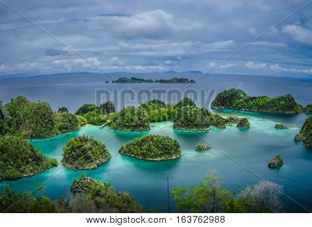 Painemo Islands, Blue Lagoon with Green Rockes, Raja Ampat, West Papua. Indonesia