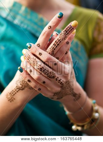 Bride henna tattoo on a woman's hands
