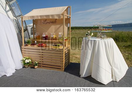 Pavillion with cold lemonade and sparkling water on a wedding day