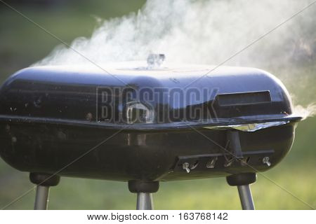 Heavy smoke from a closed barbecue grill