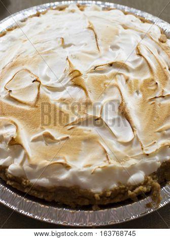 Cloe up of an uncut lemon meringue pie