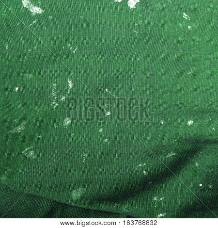 stained cloth texture for background, green color