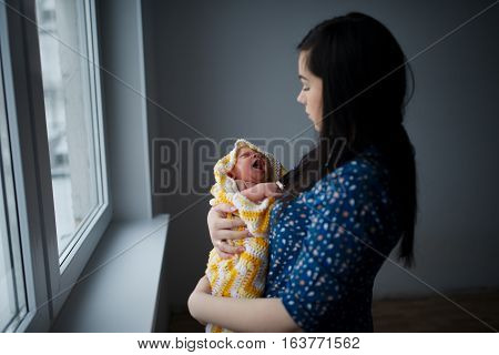 photo of young mother with newborn baby