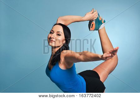 Athletic Young Woman Doing Stretching Exercises