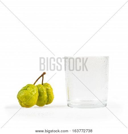 Chaenomeles japonica. Japanese Flowering Quince fruits and glass with water droplets