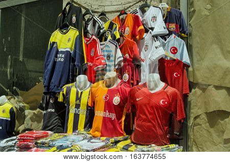 ISTANBUL TURKEY - JUNE 8 2016: Replica football team shirts for sale on a market stall on the street in Istanbul. The city has many teams including Fenerbahce Besiktas and Galatasaray.