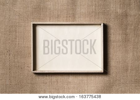 Burlap Frame Wooden Border over Sack Cloth Background Wood Frames on Fabric Texture