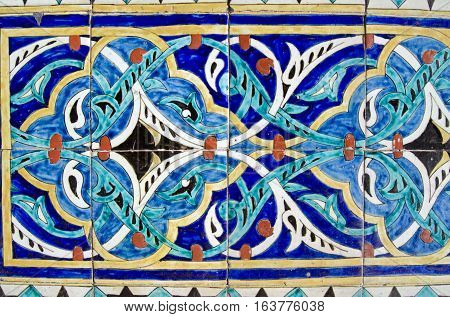 Handpainted colourful tiles decorating the exterior of an old city mosque dating from the Ottoman era in the middle of Istanbul Turkey.