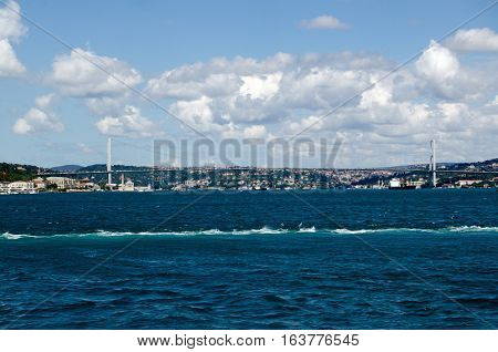 View from the sea of the First Bosphorus Bridge crossing the strait between Europe and Asia in Istanbul Turkey.