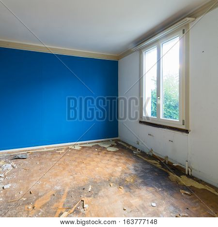 Room in house that no longer exists. Disorder chaos debris and dirt in an abandoned room for demolition.