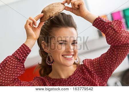 Happy Young Housewife Using Mushroom As Hat
