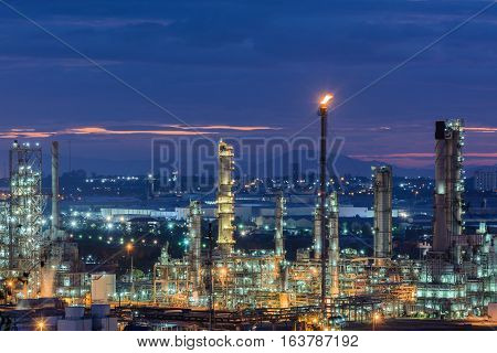 Oil refinery plant of petroleum or petrochemical industry production at sunrise