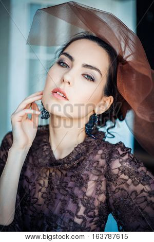 Retro portrait of a beautiful woman. Vintage style. Professional make-up and hairstyle. Fashion photo