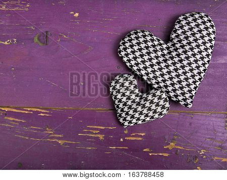 houndstooth hearts on a pinkbackground, copy space