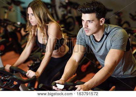 Couple In A Spinning Class Wearing Sportswear.