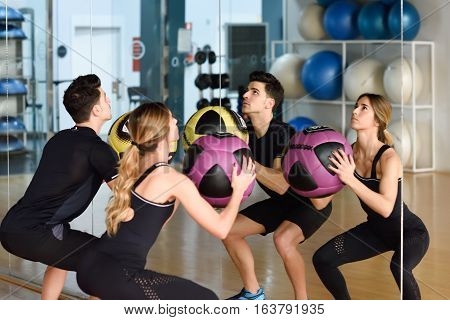 Man And Woman Liftting With In The Gym.