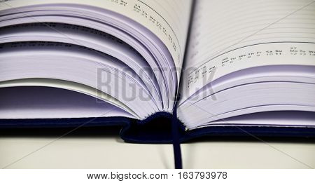 a beautiful picture with a hardbound book. a gorgeous picture that impresses the eye.