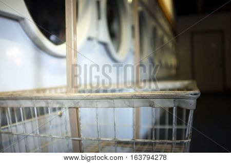 View of laundry trolley in a launderette shop.