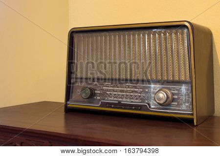 Wood Vintage Antique Analog Radio With Radio Dial On Wooden Table.