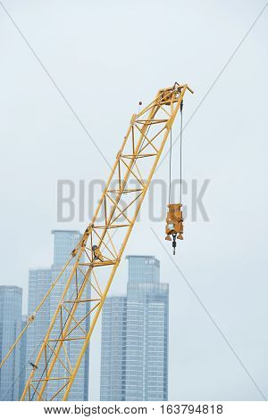 End part and hook of tower crane at a construction site.