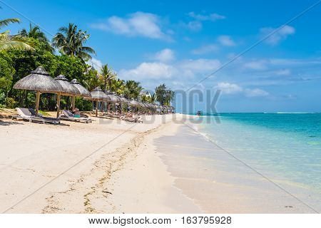 Le Morne Mauritius - December 7 2015: People relax on the Le Morne Beach Brabant one of the finest beaches in Mauritius and the site of many hotels and tourism facilities.