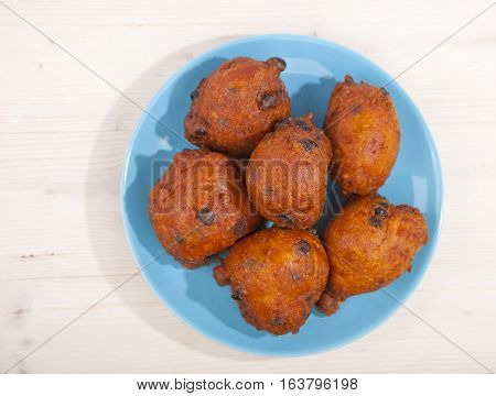 Traditional Dutch oliebollen on a wooden background
