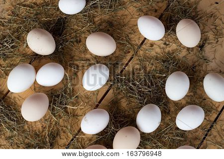 High quality tasty and healthy chicken eggs from domestic hens on wooden mat