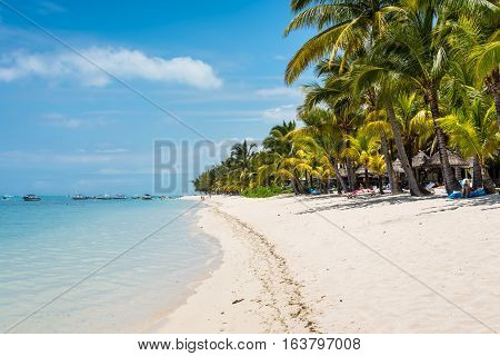Le Morne Mauritius - December 7 2015: People relax on the Le Morne Beach one of the finest beaches in Mauritius and the site of many hotels and tourism facilities.