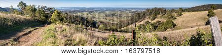 On Pokolbin Mountains Road - Panorama view of the immediate grazing area overlooking Pokolbin South. The entire district belongs to the famous Hunter Valley wine producing area.