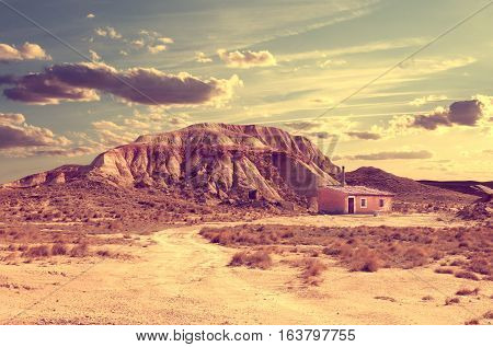 Desert lanscape.House and road in sunset landscape. Lifestyle.Solitary life in the desert